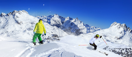 A snowboarder and ski driver on the piste in Alps in Austria Stock Photo