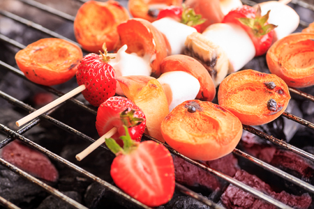 prepared: close up shut of marshmallows and fruits on the grill Stock Photo