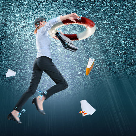 symbolic picture of a drowning office worker with a lifebelt