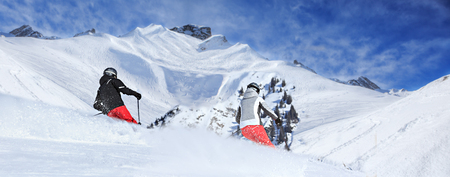 Two ski driver on the piste in Alps by Lech, Austria. photo