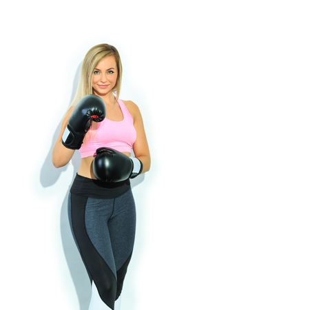 Portrait of a young woman in sport dress for fitness boxing Stock Photo