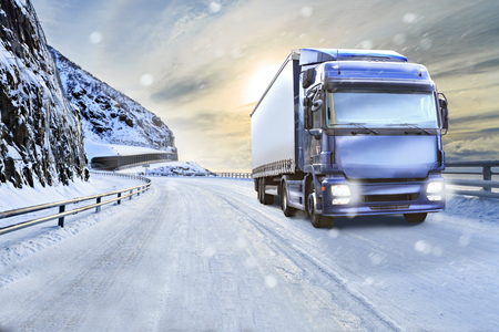 a truck on the wintry road, symbolic picture for cargo and transportation companies Stock Photo