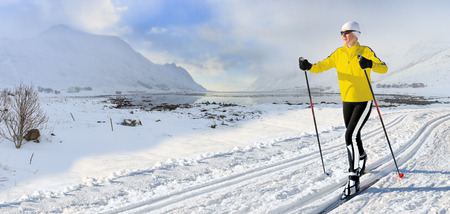 A woman cross-country skiing in the wintry landscape of Norway Stock fotó
