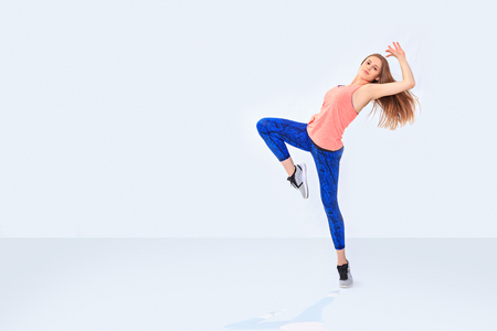 a young girl in sport dress by dancing aerobics or fitness exercise