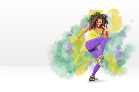 a young woman at fitness exercise or zumba dancing