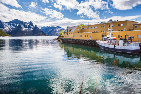 The port of Husoy village on Senja Island beyond the Polar Circle in Norway