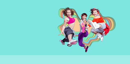 group of  women in sport dress jumping at fitness, dance, aerobics exercise