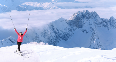 A young woman skiing in the mountains