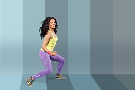 A young woman dancing aerobics, zumba or fitness dance Stock Photo