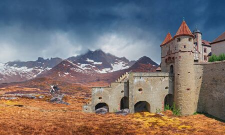 A fantasy landscape of a mountainous rough country with a castle 写真素材