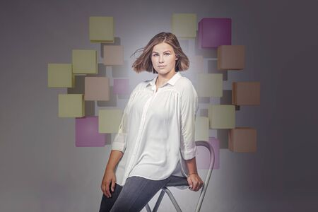 A studio portrait of the 18 year-old girl in business outfit