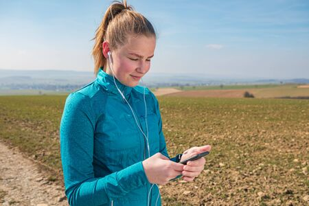 young girl jogging on rural trail at spring time