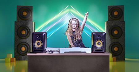 a gradeschooler girl as DJ at the kids disco Stock Photo