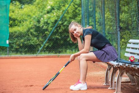 female tennis player with a racket on the court