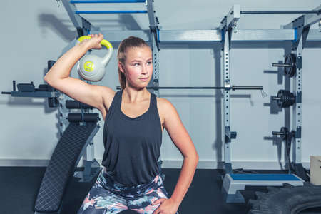 young girl working out in the gym or fitness room
