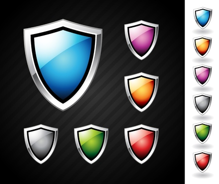 shield emblem: Scudi lucidi e colorati con i bordi di cromo Vettoriali