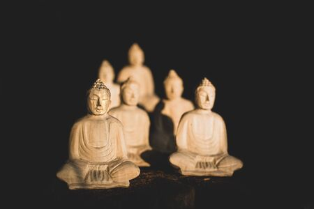 wooden buddha statues sitted in lotus 写真素材