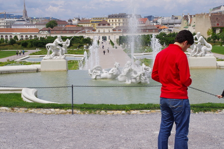 Belvedere Vienna fountain and young man