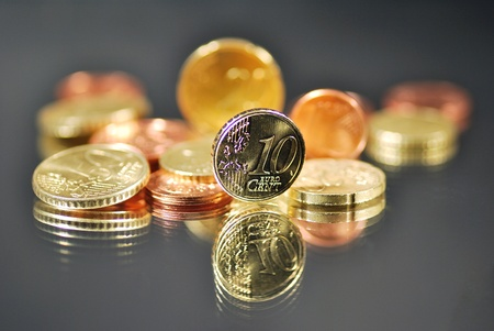 many coins fo euro are stacked, earn count and sort photo