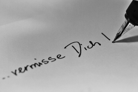 miss: message written on a letter - I miss you!