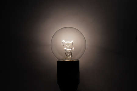 bulb shines in the darkness Stock Photo - 9378129