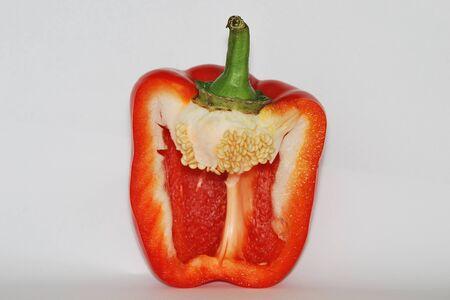 juicy ripe sweet red pepper cut in half photo