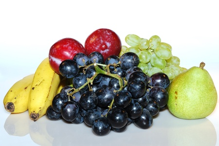 many fresh healthy range of fruits, apple banana grapes photo