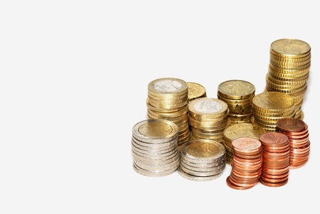 counted: euro coins stacked and counted income Stock Photo
