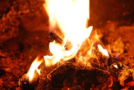 nice warm fire with embers to relax at the tent Archivio Fotografico