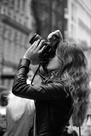 pretty young photographer when shooting in the city