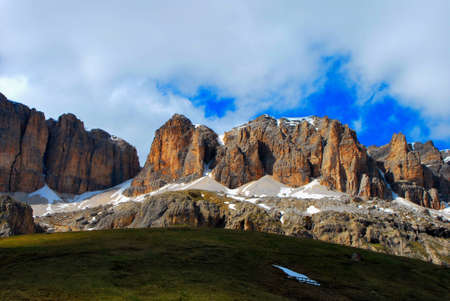 steep and rocky mountain in the Dolomites in summer photo