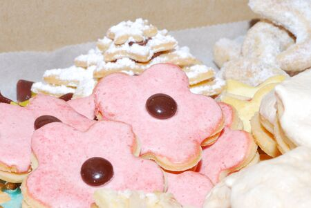 colored pink sweet biscuit baked to celebrate or Christmas photo