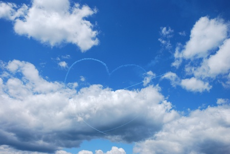 generates: a plane generates with the fog a heart with an arrow at a flight show Stock Photo
