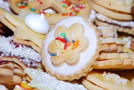 many colorful sweet biscuit with sugar on christmas photo