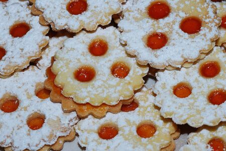 biscuit with three eyes filled with jam on christmas photo