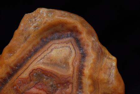 edel: large brown stone mineral in quartz macro view Stock Photo