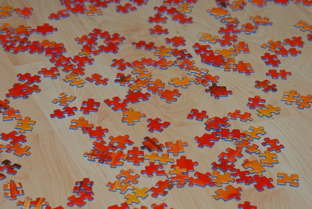 many red puzzle stones scattered on the wooden floor to play Stock Photo - 13282607