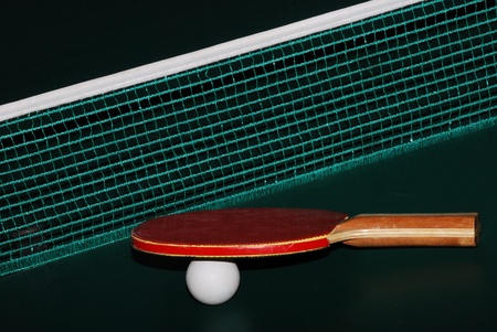 great view table tennis racket and ball grid at table tennis table Stock Photo - 13282599