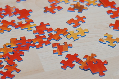 many orange puzzle blocks lie on subsoil of wood ready to build together and play Stock Photo - 13282589