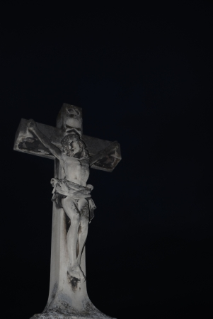 cross with jesus image to portrait cemetery in the night photo