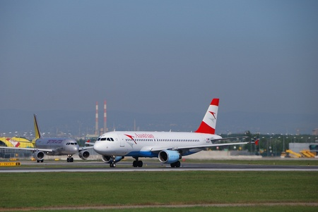 plane of the line before the start austrian airlines at the airport in summer