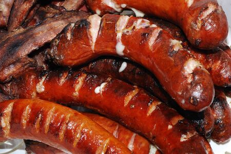 fresh grilled hot sausage with cheese griller in the summer photo