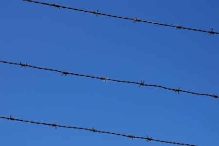 freedom barbed triple flat with blue sky Stock Photo - 14969962