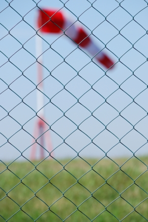 red white buoy wind behind a fence for the determination of wind direction photo