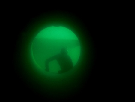 free diver: apnea diver or free diver looking through a long tube in the lake Stock Photo