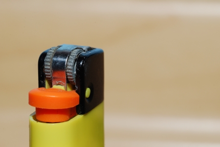 yellow lighter in big close-up macro Stock Photo - 18881938