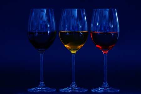three glasses with different colored liquids blue photo
