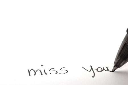miss you: miss you written on a white paper letter Stock Photo
