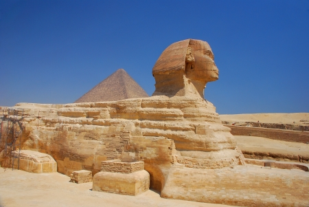 egypt sphinx in full side view with blue sky Stock Photo