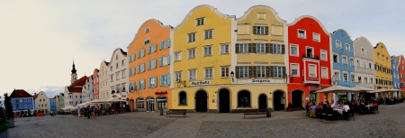 many colorful houses in a baroque city panorama
